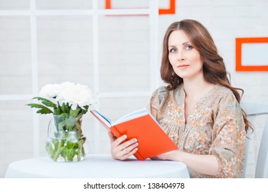 Portrait of a beautiful woman with a book