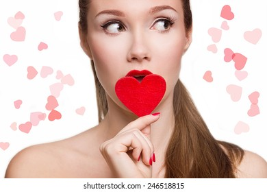 Portrait of Beautiful woman with bright makeup and red heart in hand