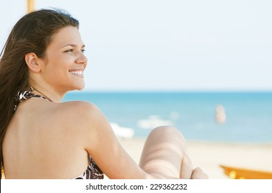 Portrait of a beautiful woman by the sea