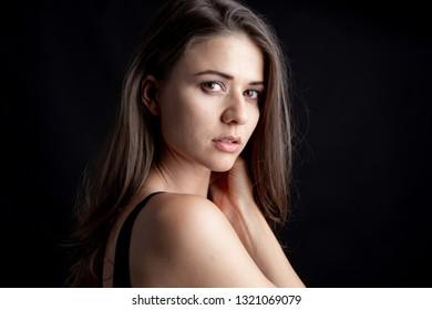 Portrait of a beautiful woman cute girl, Picture taken in studio on black background
