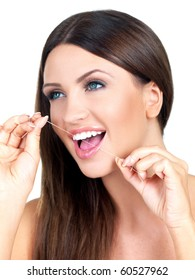 Portrait of beautiful woman with dental thread