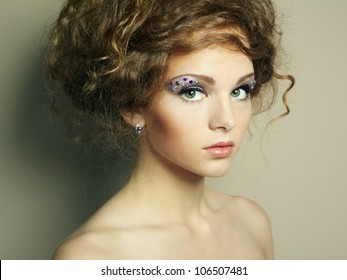 Portrait of beautiful  woman with elegant hairstyle. Fashion photo