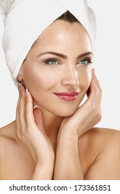 Portrait of a beautiful woman enjoying spa treatment on neutral background