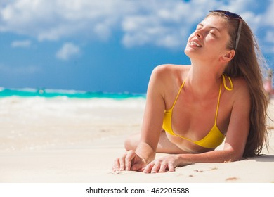 portrait of beautiful woman enjoying sunny day at beach