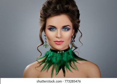 Portrait of beautiful woman with expensive earrings and stylish necklace