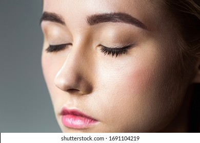 Portrait of a beautiful woman with eyelashes and eyebrow correction