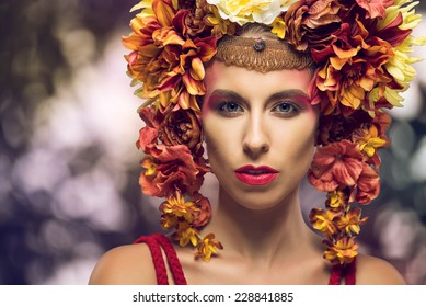 Portrait of a beautiful woman with flowery headpiece