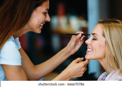 Portrait of beautiful woman getting cosmetic care at beauty salon