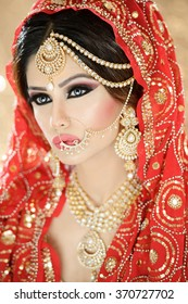 Portrait of a beautiful woman in glamorous outfit and jewellery with makeup