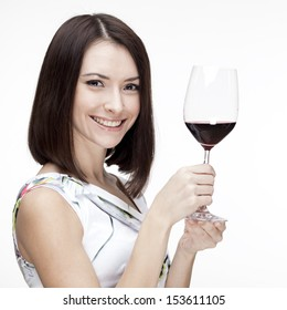 Portrait of beautiful woman with glass red wine