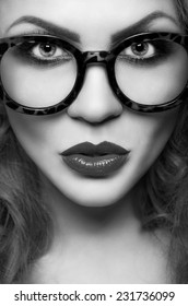 Portrait of a beautiful woman in glasses close up