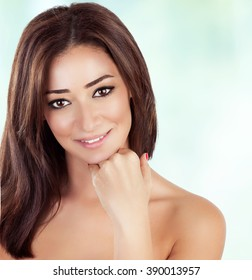 Portrait of beautiful woman with gorgeous brown hair over clear background, spending day in beauty salon, healthy treatment, enjoying day spa