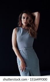 Portrait of a beautiful woman in a gray dress