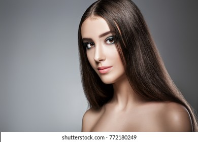 portrait of a beautiful woman with a green evening make-up on a dark background