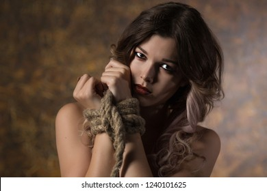 portrait of a beautiful woman with hands tied humiliation