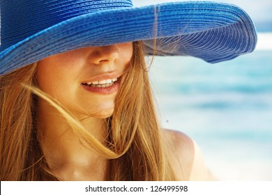 Portrait of a beautiful woman in the hat