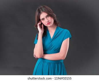 Portrait of a beautiful woman heavy thoughts fill her mind. Bothered gloomy female frowning being perplexed and frustrated