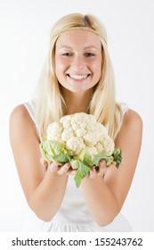 Portrait of beautiful woman holding cauliflower.