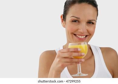 Portrait of beautiful woman holding glass of orange juice