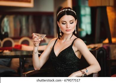 Portrait of beautiful woman holding glass of martini