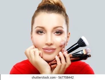 Portrait of beautiful woman holding make-up brushes.Putting makeup .Contouring.Make up woman face. Contour and highlight makeup.