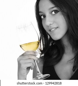 Portrait of a beautiful woman holding white wine