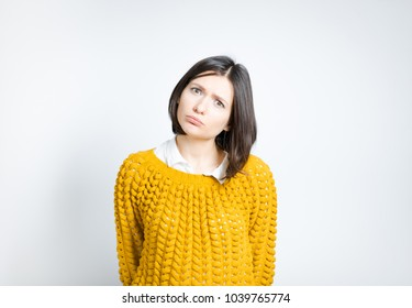 portrait of a beautiful woman interested in something, isolated on a gray background