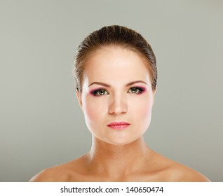 Portrait of beautiful woman, isolated on beige background