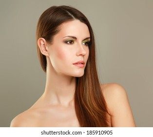 Portrait of beautiful woman, isolated on grey background