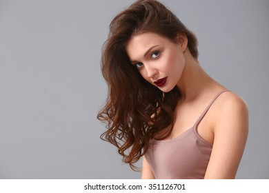 Portrait of beautiful woman , isolated on gray background