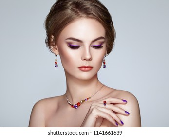 Portrait Beautiful Woman with Jewelry. Model Girl with Violet Manicure on Nails. Elegant Hairstyle. Violet Make-up Arrows. Beauty and Accessories