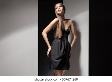 Portrait of beautiful woman in little black dress