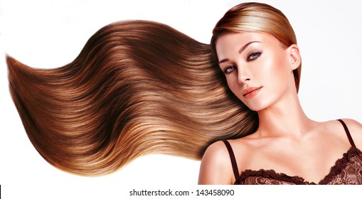 Portrait of the beautiful woman with long brown hair.