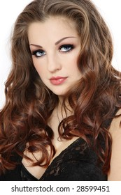 Portrait of beautiful woman with long curly hair and smoky eyes