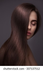 portrait of Beautiful Woman with Long Hair isolated over dark background