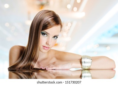 Portrait of beautiful woman with long straight hairs and fashion makeup of eyes
