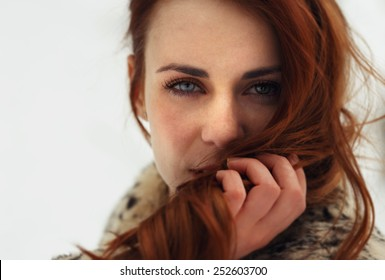 Portrait of beautiful woman looking to camera