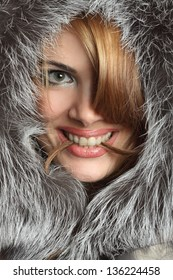 portrait of a beautiful woman with luxuriant fur