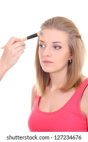 portrait of beautiful woman with make-up brush