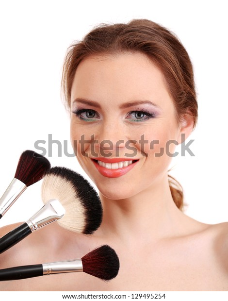 portrait of beautiful woman with make-up brushes, isolated on white