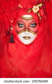 portrait of a beautiful woman with make-up styled Venetian mask