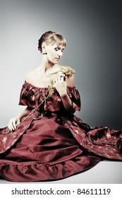 Portrait of a beautiful woman in medieval era dress. Shot in a studio.