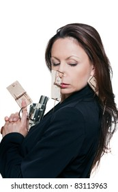 Portrait of beautiful woman with mousetraps holding revolver in studio isolated on white background