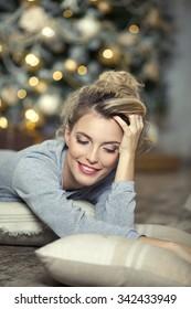 Portrait of a beautiful woman near the Christmas tree