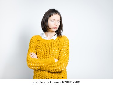 portrait of a beautiful woman offended, isolated on a gray background