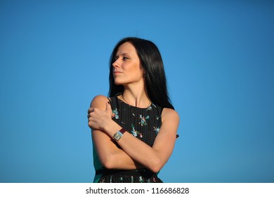 portrait of a beautiful woman on the background of blue sky