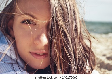 The portrait of beautiful woman on the beach
