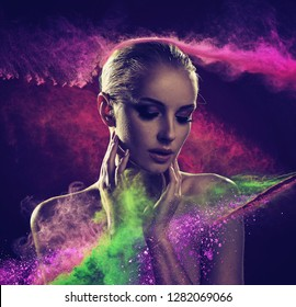 Portrait of beautiful woman , on a dark particles backbround
