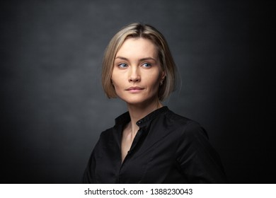Portrait of a beautiful woman on a dark background