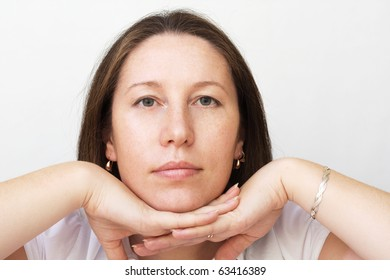 Portrait of the beautiful woman on gray background